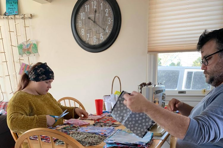 Molly and Ralph Petty making masks.