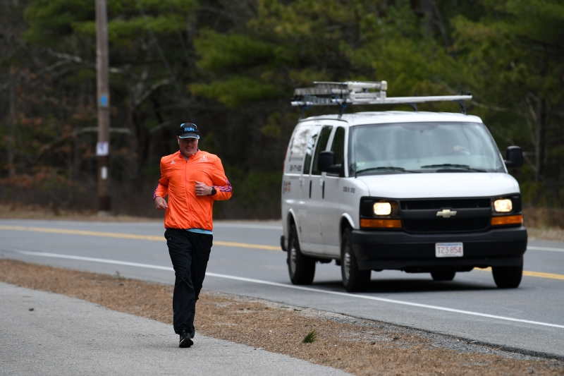 Matt Auger running on Great Neck Road in Mashpee on Patriots Day 2020.