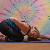Sarah Daley doing a yoga pose