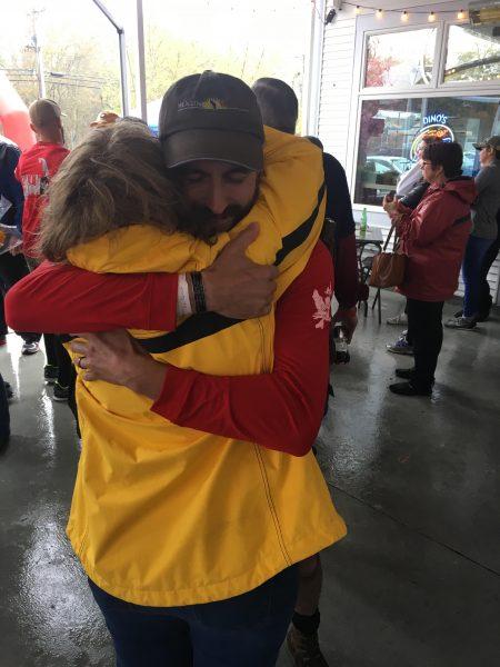 Cyndy Jones hugs Alec Reisberg at the end of the 2017 Ruck4HIT