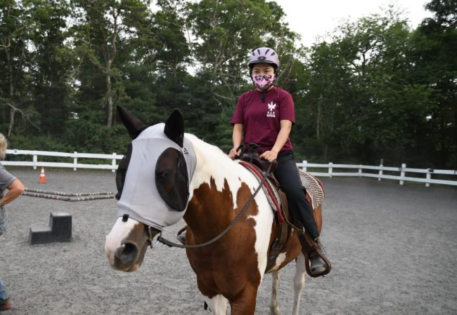 Rose Perez riding a horse during the final day of Families In Transition (FIT) Week in July 2020.